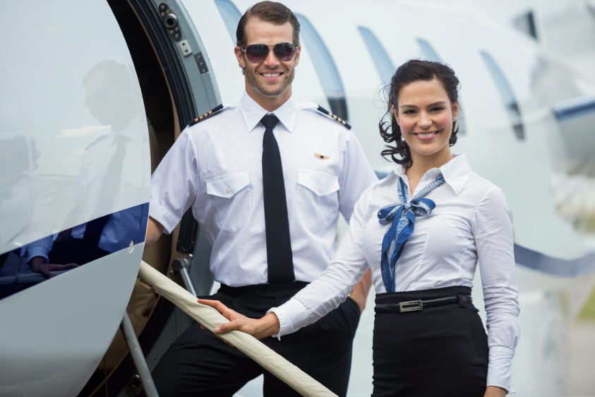 Pilot and flight attendant about to board a plane